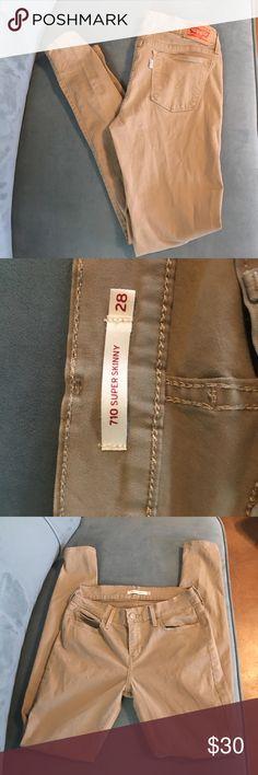 Levi's 710 Super Skinny Jeans Size 28 Never worn Levi's 710 Super Skinny jeans. Color: tan         Women's size 28 Levi's Jeans Skinny