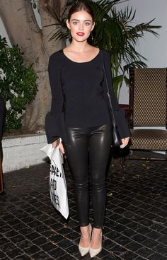 Lucy Hale in a black long sleeve top and leather pants