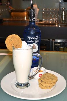 Warm Chocolate Chip Cookie  1.5 oz. Pinnacle Chocolate Whipped Vodka  1 oz. Créme de Cacao  1 oz. Monin Shortbread syrup  8 oz. Milk, steamed and frothed  Add the first 3 ingredients to a glass (Libbey 14 oz. cafe mug) of steamed milk. For an extra kick add an Illy espresso. Garnish with whipped cream and a mini chocolate chip cookie. Cheers!