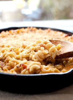 Cast Iron Mac and Cheese: A made-from-scratch mac and cheese with just enough bacon and spice, mixed together and baked in a cast iron skillet for crispy edges!