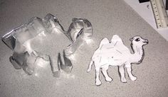 Make your own cookie cutter from clip art and a foil pan.  A more intricate shape
