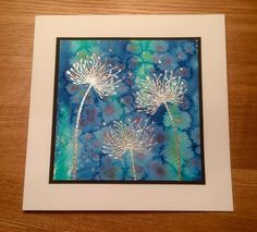 handmade card from Wendy's Craft ... watercolor with salt technique background ... dandelions heat embossed with silver tinsel powder ... framed like the piece of art it is ...