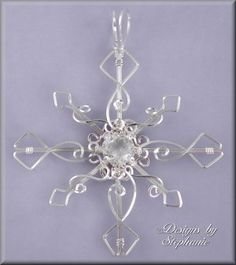Wire wrapped snowflake -- I am horribly prejudiced against snowflakes that don't have six points, so please, if you make this, put SIX points on it.  Thanks.  I feel better now.