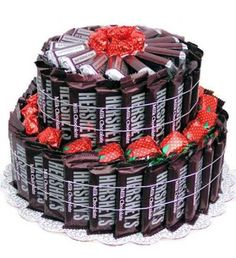 This Hershey Cake Bouquet is perfect for Birthday 's or any other occasion.This two tier cake is made up of 50 fun size Hershey 's Chocolate bars 15 Miniatures, 25 Strawberry filled candies packaged on cake board, wrapped in cellophane gift bag & tied with ribbon.