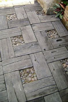Genius! these are tiles that look like drift wood and peeble garden pavers