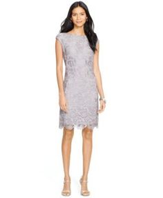 Lauren Ralph Lauren's charming lace dress features a pretty scalloped hem and an ultra-soft stretch lining. | Polyester; lining: polyester/elastane | Dry clean | Imported | Concealed zipper with a hoo