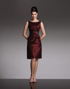 Social Occasions by Mon Cheri - 28872 -     Sleeveless stretch taffeta knee-length sheath with bateau neckline, side gathered bodice features sash accent with jewel brooch, pleated deep V back bodice. Matching shawl included (not shown).  Sizes: 4 – 20      Colors: Wine, Black, Navy Blue, Cocoa