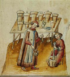 """A pharmacist and his assistant pound herbs and roots for medical use. From """"Tacuinum Sanitatis"""", a medical codex, written and illuminated for the Cerruti Family, probably from Verona (end 14th)"""