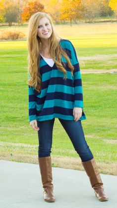 Put Up A Good Stripe Top   DazyLu. Cute find more women fashion ideas on www.Dazylu.com. DazyLu is a women's clothing, shoes, and accessories boutique.  #FREESHIPPING #boutique #fall fashion #sweater #cardigan #tunic #stripes #vest #fur #pants #scarf #dress #holiday #booties #boots #wedges