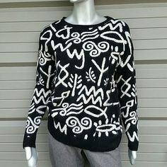 Tribal Black & Cream Sweater by Forever21 Brand Forever 21  Size Small Oversize fit 50 % Nylon 31%Polyester 11% Wool 5% Angora Rabbit Hair, Hand wash cold water will be home dry cleaned before it's journey  Classic round neck style Sweater with tribal design in black and cream. Ribbed hem, cuff and neck. Very nice condition comes from Florida hardly worn. Bundles available with discounts Forever 21 Sweaters Crew & Scoop Necks