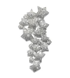 "An important platinum and diamond-set ""22 stars"" brooch   by Suzanne Belperron"