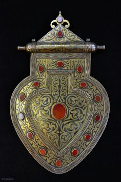 Central Asia | Tekke asyk dorsal pendant; silver, silver gilt and carnelian. |  ca. late 19th century | Price on request
