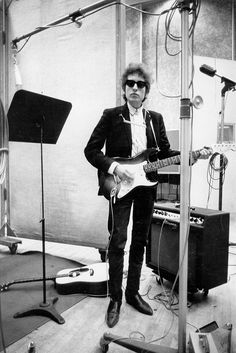 Bob Dylan plays a Fender Stratocaster electric guitar through an Ampeg amplifier while recording his album 'Bringing It All Back Home' on January 13-15, 1965 in Columbia's Studio A in New York City, New York  Photo: Michael Ochs Archives - .