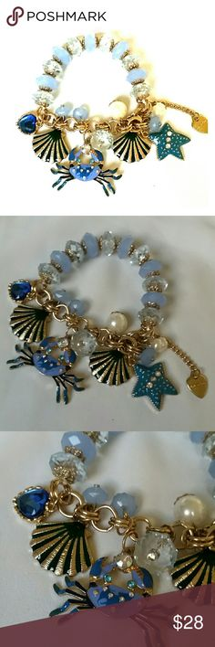 "NWOT Betsey Johnson Crab & Shells Charm Bracelet New without tags, never worn, Betsey Johnson charm bracelet featuring enameled over shiny gold metal seashells and a crab in multiple shades of blue and green, from periwinkle to teal and deep ocean. Lots of rhinestone crystal and larger resin gems sparkle all over, and around, along with a BJ signature heart charm. Stretch bracelet, half elastic, half chain, inside diameter 6"".  Thank you for checking out my closet, and happy poshing!! :)…"