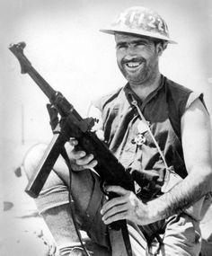 Australian digger with captured German MP40 submachine gun, and wearing an…