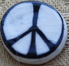 Photo of the first peace badge made by Eric Austen for the Campaign for Nuclear Disarmament in 1958 from Gerald Holtom's original design.