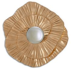 Plissage Mirror - Christopher Guy With a continuous circular swirl of hand carved pleats around a convex pane, this stunning mirror makes the ultimate statement piece.