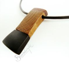 WOODEN JEWELRY - Wooden unique designed necklace - oak, black ebony and mahagony wood, with 3mm leather cord. €40,00, via Etsy.