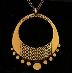 "Pentti Sarpaneva for Turun Hopea,  Vintage bronze ""Lehti"" pendant, 1960's. #Finland | FinlandJewelry.com"