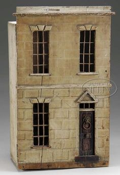 """Dollhouse; Regency, Box-Back, 2-Story, Faux Limestone, Carry Handle, Furnishings, 3 Grodnertal Dolls, 28 inch. A Regency two-story, two-room dollhouse and contents, having a faux limestone facade, a carrying handle on the roof, lion's head door knocker with ring, brass doorknob on the paneled """"mahogany"""" front door, its original wallpapers, and an Evans & Cartwright fireplace, along with various furnishings and three Grodnertal dolls."""
