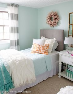 """Sophisticated teenage girls bedroom makeover. Light green walls """"green trance"""" by Sherwin-Williams + blue, white, orange and pink home decor accents"""