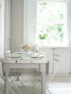 Love this sweet little breakfast nook. The rustic table, painted floors, huge open windows, all give off a simple and calming effect.