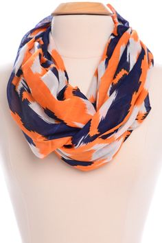 We loooove this comfy and cozy number for fall layering! Infinity scarves are one of our fave trends right now and this one would be great to bust out for a chilly gameday!