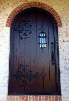 Masterpiece Doors & Shutters  Custom Single Door - Hobbit Door - Large Strap Hinges - Rustic Distressed Walnut - Wrought Iron Styling - Zero Maintenace Composite! www.masterpiecedoors.com - 678-894-1450