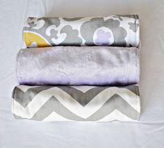 A personal favorite from my Etsy shop https://www.etsy.com/listing/211032916/lavender-and-gray-burp-cloth-set