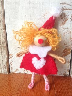 https://www.etsy.com/listing/218901006/waldorf-style-bendy-doll-valentines-day  Little valentines day circus clown Waldorf inspired bendy doll  By: A Curious Twirl