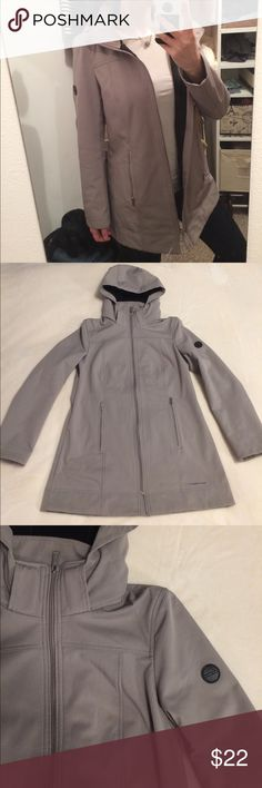 """Andrew Marc Soft Shell Trench Coat EUC! Water repellent, 4-way stretch, & detachable hood. Color: taupe grayish. Size small. Stylish and professional! Length is 1"""" past my bottom (I'm 5'6). Let me know if you have any questions! Andrew Marc Jackets & Coats Trench Coats"""