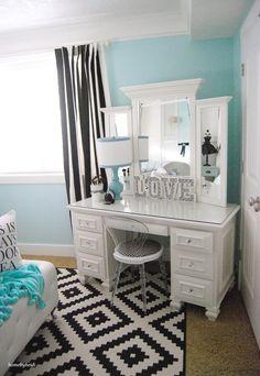 White, blue and black teen vanity decor.