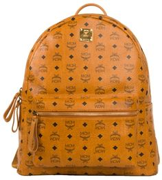 MCM large Stark backpack with out embellishments is available in Cognac Vistos. This season MCM released a wide array of backpacks. The most difficult to find are the collector's MCM Stark backpack. Perfect for men or women, this MCM Bag has logo monogram print on leather. The backpack ships directly from Pure Atlanta with an authenticity card and dust bag from MCM. Size: Large (Largest size MCM backpack available) Stark No Stud MCM logo backpack. Available at PureAtlanta.com