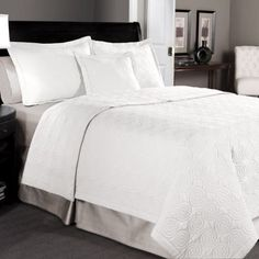 Solid White Cotton Quilt Bedding Queen Set Will Match Any Sheets Easily. Bedding Is Rich Durable and Simple. The Matching Shams Complete the Look. The Bedding Set Features Swirly Circular Quilted Designs. It Is a Great Alternative to a Comforter. Maison White http://www.amazon.com/dp/B00LDEKBXI/ref=cm_sw_r_pi_dp_noWUtb1GQEAMRWB9