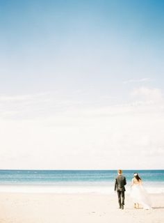 "Love this- opportunity to capture the beach without the overwhelming sense of ""wedding photo"" great for a large canvas in the living room"