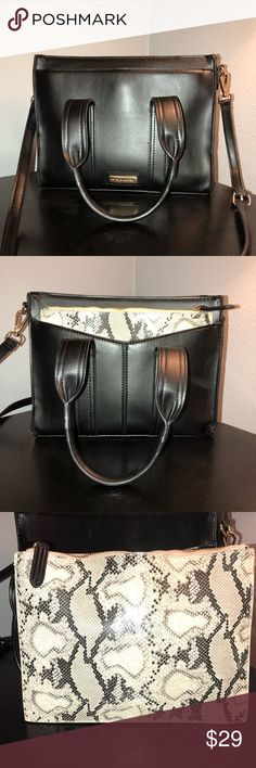 Steve Madden handbag Steve Madden handbag with removable full size snakeskin pouch. Minor wear and tear (pictured) nail polish stain inside (pictured) other than that it's in great condition. Large size lots of space inside! Comes with a long strap Steve Madden Bags Satchels