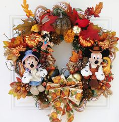 Thanksgiving Fall Mickey and Minnie Mouse Wreath by SparkleForYourCastle on Etsy. (Maybe could make a version of it though for less $$)