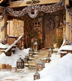 Natural garlands and Christmas wreaths with lanterns, Front door decoration for winter holidays