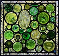 Daniel Maher created panel from the bottoms of bottles, bases and stem ware along with antique pressed glass objects ... border is made from pale lavender depression glass plates