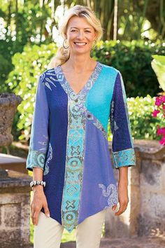 """Vibrant gem-toned panels with intricate motifs present modern color-blocking - batik-style - in this soft, exotic tunic. With a shapely surplice design, three-quarter sleeves and a point hem. Rayon. Misses 34"""" long. Spice Island Tunic #27871"""