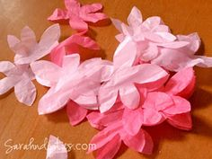 """While the snow has still been falling here for the past couple of days, my thoughts have been turing to Spring. I thought I'd share my tutorial on how to make Tissue Paper Cherry Blossoms here!   Tissue Paper Cherry Blossoms  Materials Needed: Pink tissue paper (I've used both hot pink and light pink) Dead branches (I got mine out of the pile of wood pruned from the trees in the fall) Hot glue and glue gun Scissors  First, fold the tissue into squares about 3"""" big:"""