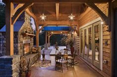 WA couple finishes a timber frame home themselves, saving money; offering a world of satisfaction. Self-built porch with fire place. Decks And Porches, Back Porches, Porch Fireplace, Fireplace Facing, Outdoor Spaces, Outdoor Living, Timber House, Home Photo, Log Homes