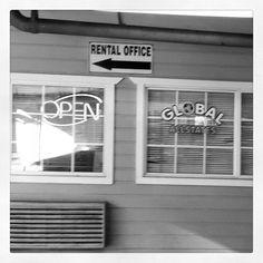 Roadside shop - Raphael Love Social Media Mentor and Speaker Arrow, Garage Doors, Corner, Real Estate, Social Media, Spaces, Black And White, Outdoor Decor, Shopping