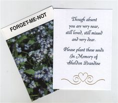 Memorial Seed Packet Favors - I like the idea of having packets of seeds by the guest book, though forget-me-nots seem a bit pat.