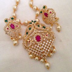 CZ and ruby & emerald pendant set Code : PS 375 Price: Rps. 1295/- Whatsap to 09581193795 for order processing