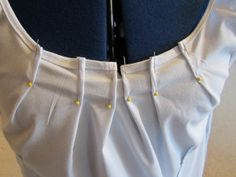 DIY shirt refashion tutorial --- It looks like this could be done with an oversized t-shirt too.