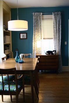 Great mid century modern dining room/library.  Love the shade and the wall color.