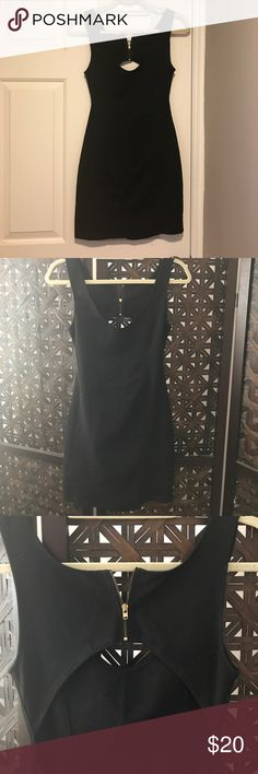 Sexy little black dress! Very unique back! Some wear around the under arms Dresses Mini