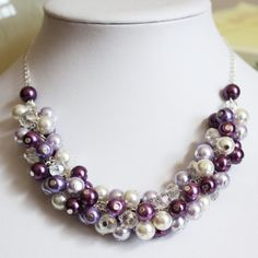 Hmmm...well these are my wedding colors...Bridesmaid Jewelry Purple Lilac Plum Ivory by DaisyBeadzJoaillerie