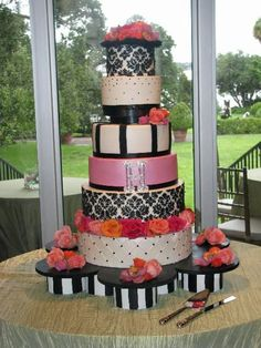 This design was inspired by the lindees original design.  A big thanks to her for such a great design.  My bride saw the picture and was in love with it.  The round wedding cake is 6, 8, 10, 12, 14, and 16 tiers in all buttercream.  Fresh roses and orchids in the brides colors of cerise, orange, pink, green, and purple were used.  Handmade crystal H monogram.